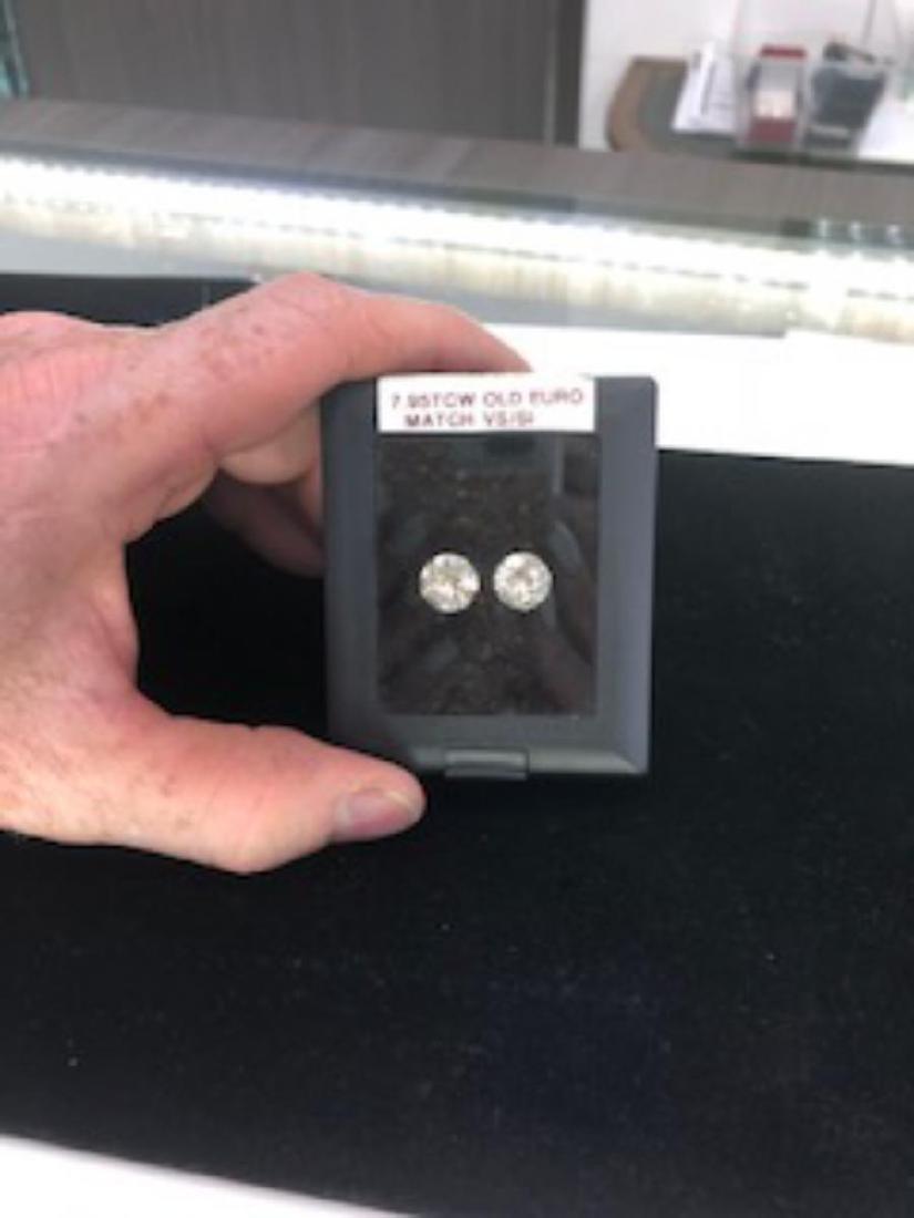 7.95ctw Pair of Round Diamonds