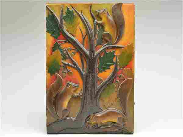 Extraordinary and early carved decorative wall plaque,