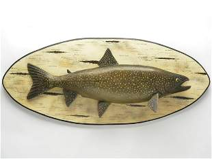 Carved and painted lake trout on plaque, Lawrence