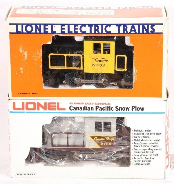 9: NETTE - 2 LIONEL Modern Motorized Snow Plows: