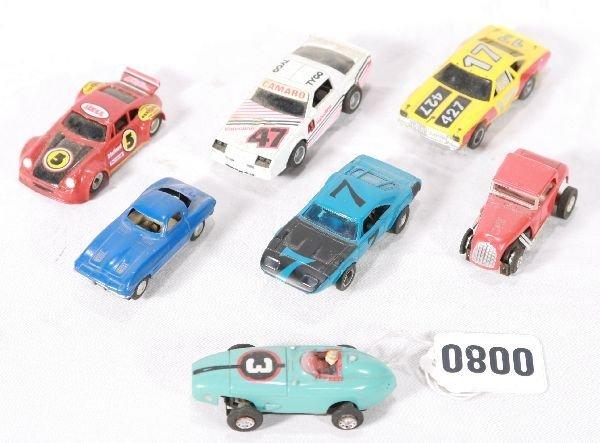 193: NETTE - 8 Pc. AURORA, TYCO, LIONEL Slot Cars: