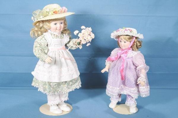 7: 2 Boxed DANBURY MINT Porcelain Dolls