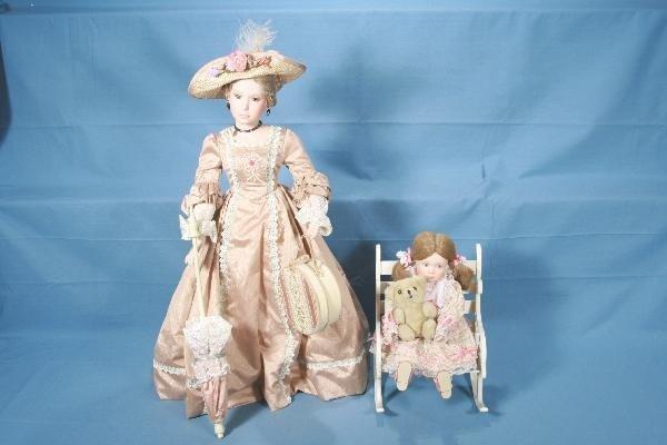 12: 2 Boxed DANBURY MINT Porcelain Dolls