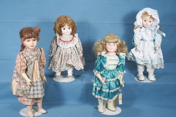 14: 4 Boxed Porcelain Dolls
