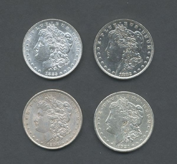 15: Four Silver Morgan Dollars