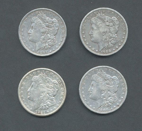 16: Four Silver Morgan Dollars