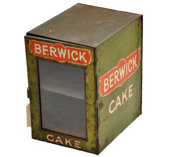6: Unusual Berwick Cake Display Tin