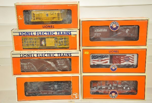 14: 7 Boxed Lionel Freight Cars
