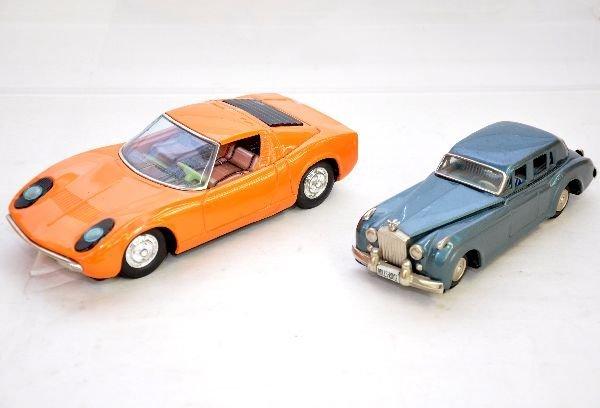 13: 2 Vintage Tin Vehicles