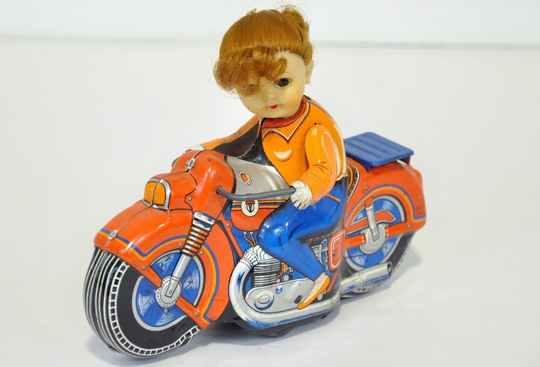 Unusual Japanese Girl On Motorcycle