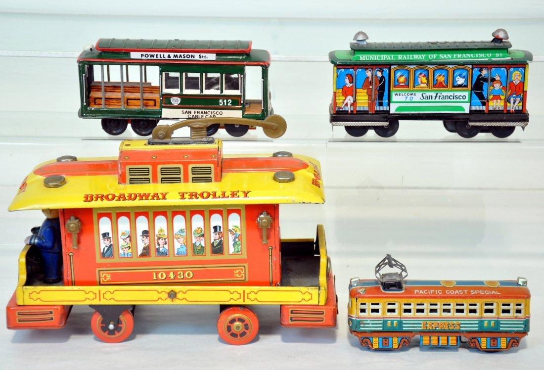 4 Vintage Japanese Tin Trolleys