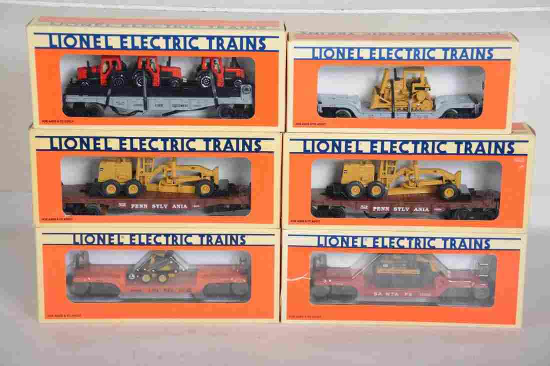 O Ga. Lionel Flat Cars with Diecast Construction Trucks