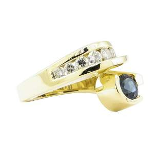 1.85 ctw Blue Sapphire And Diamond Ring - 14KT Yellow
