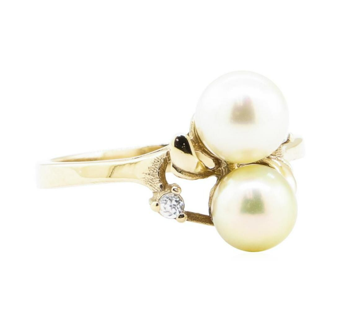 0.08 ctw Diamond and 7mm Round Cultured Pearl Ring -