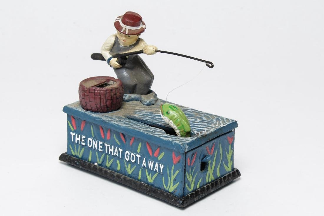 "Cast Iron Mechanical Bank, ""The One that Got Away"""