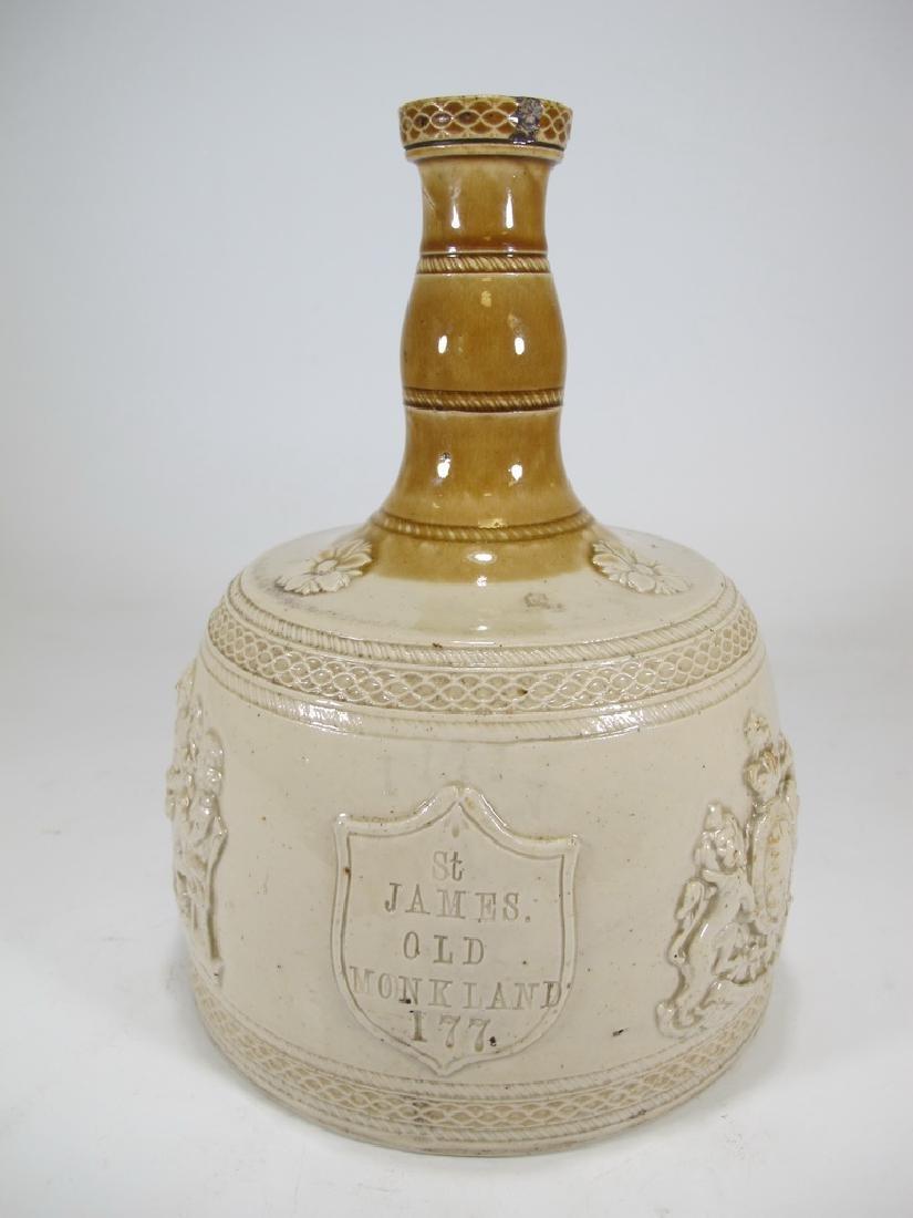 Antique masonic stoneware decanter