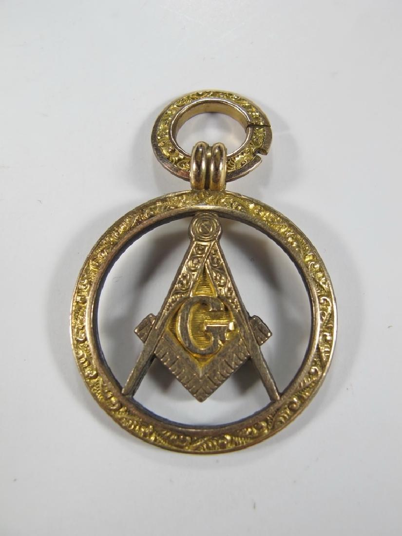 Antique Masonic 10k gold round pendant