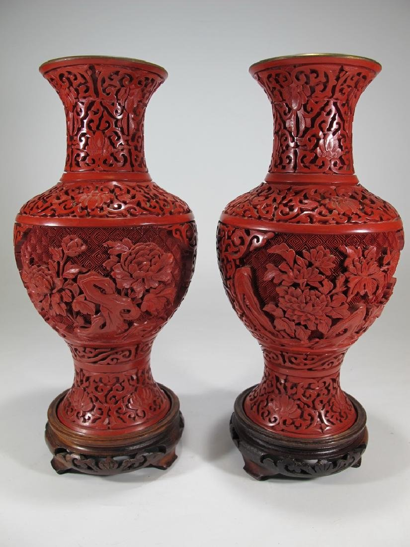 Vintage Chinese pair of cinnabar vases with a wood base