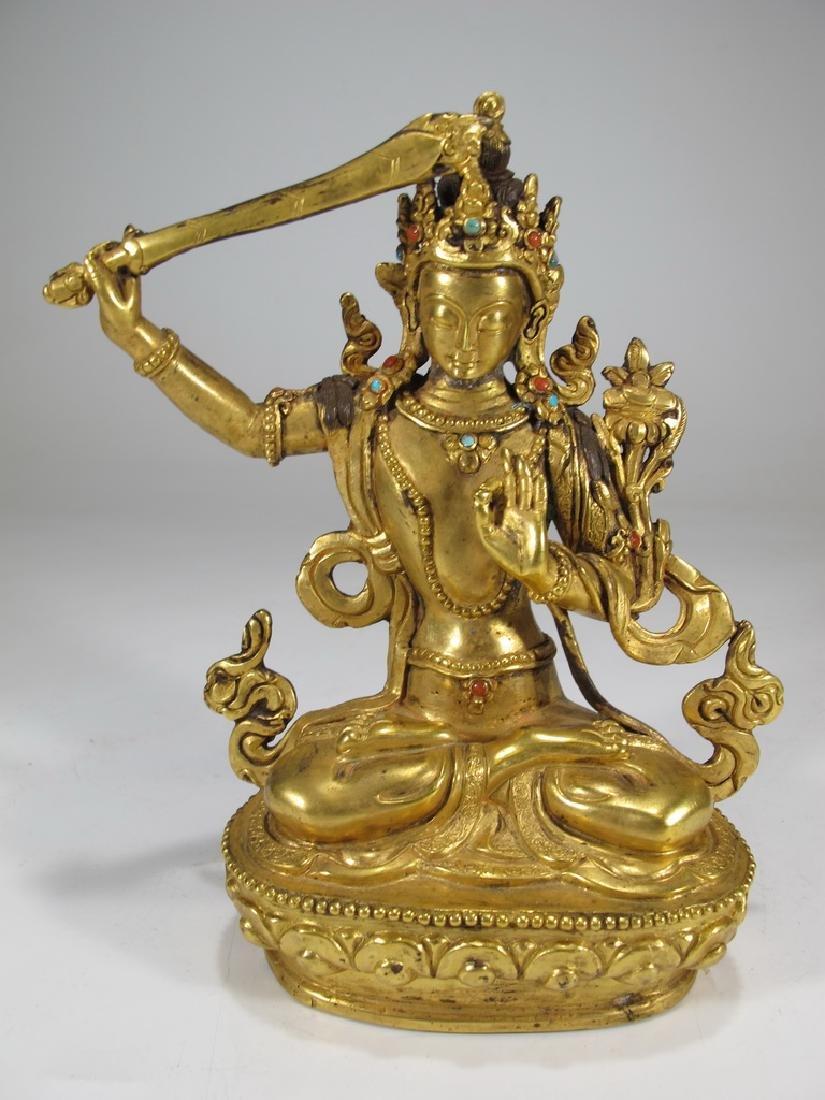 Antique Tibetan gilt bronze statue with turquoise &