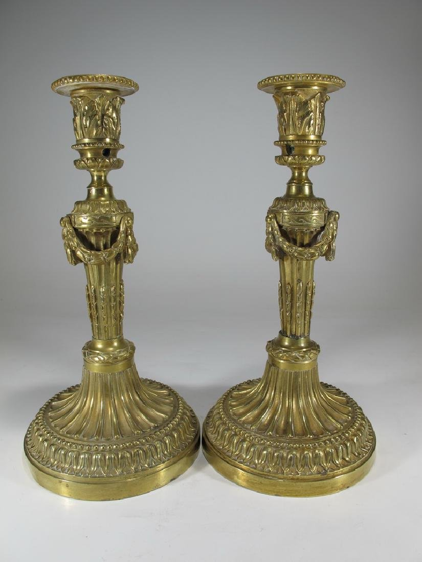 Antique pair of French bronze candlesticks