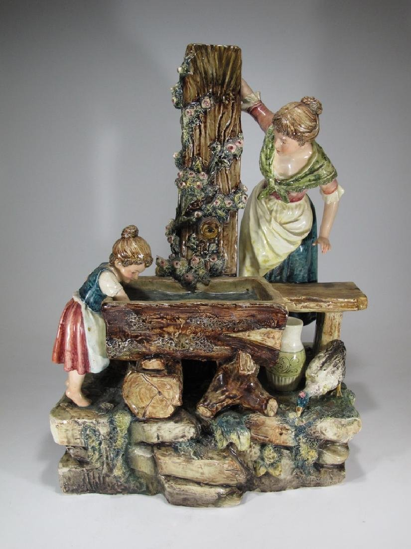 Antique European majolica washerwoman sculpture