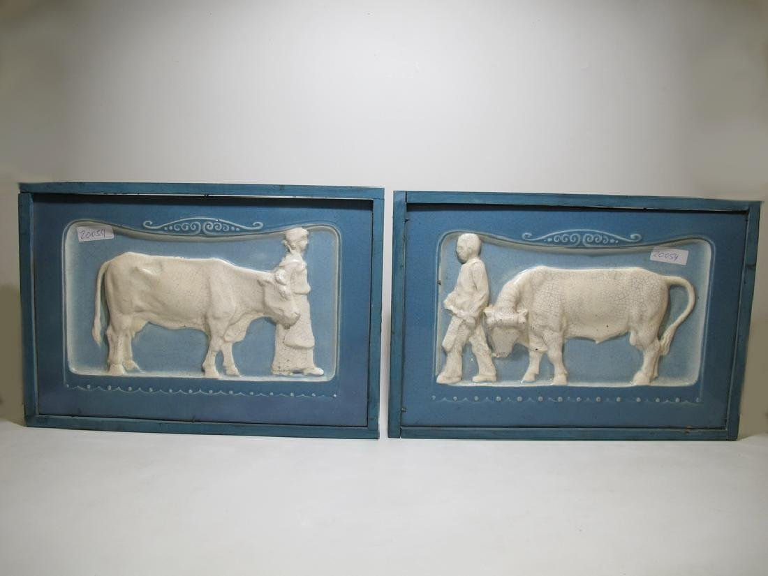 Antique European pair of ceramic plaques