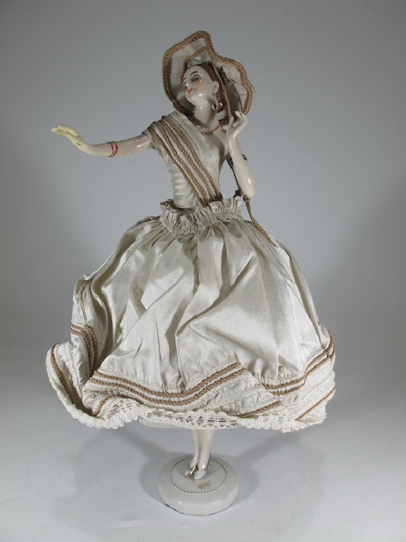 Antique French porcelain & silk doll