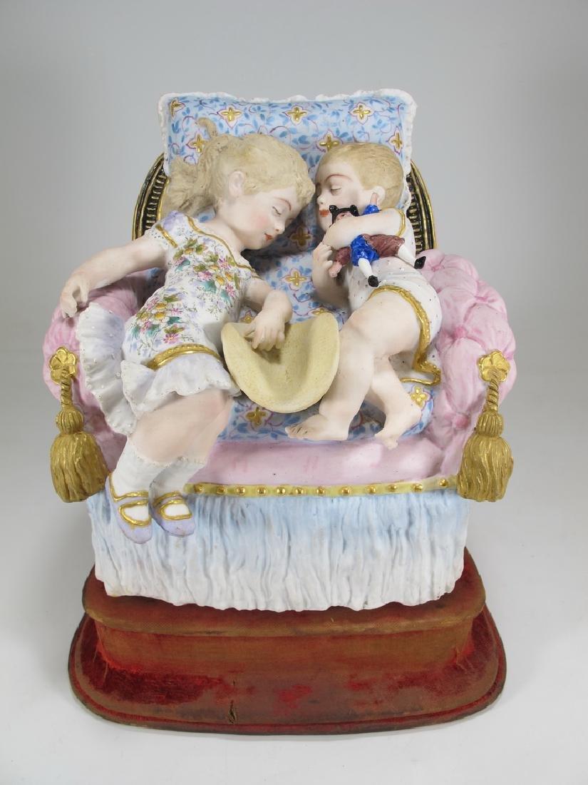 Antique German bisque kids statue