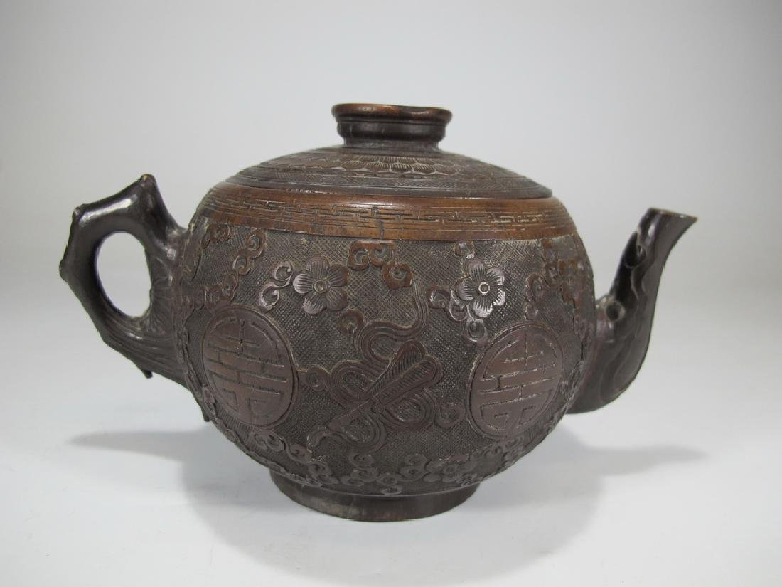 Antique hand carved coconut teapot