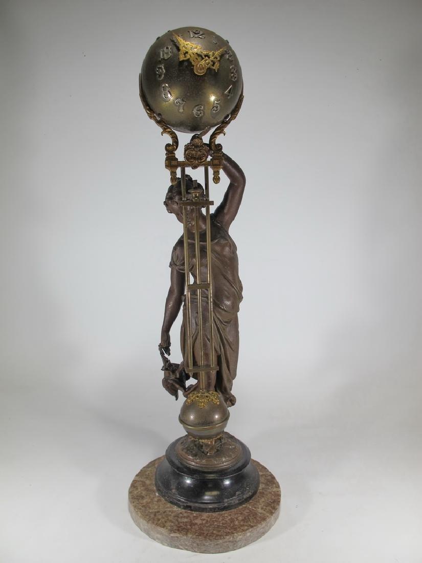 Antique French spelter & bronze swinging clock