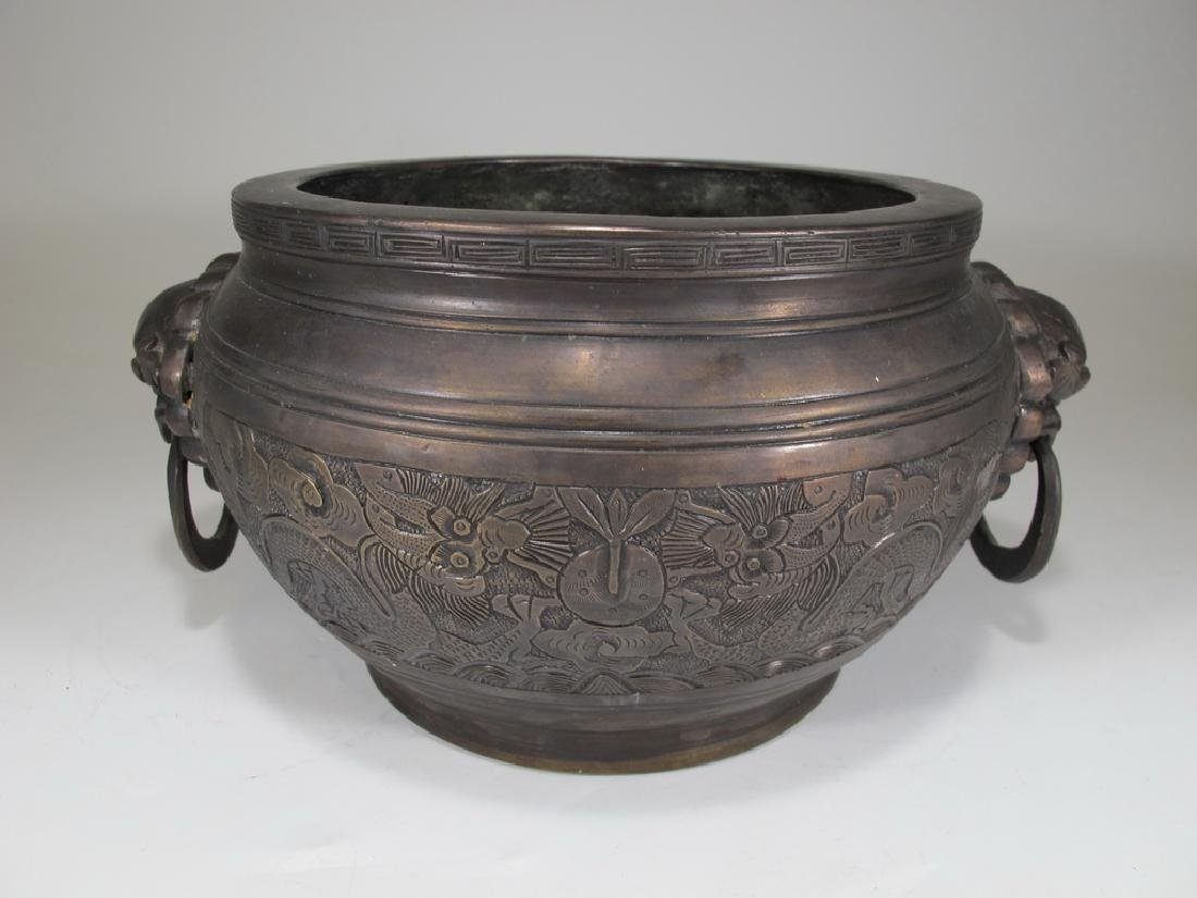 Antique Chinese bronze bowl with foo dogs handles