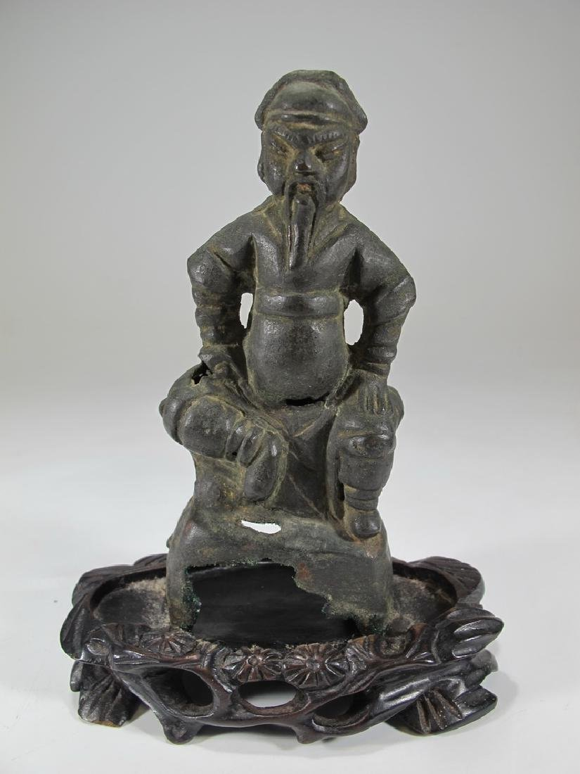 Antique Chinese bronze sculpture with a wood base