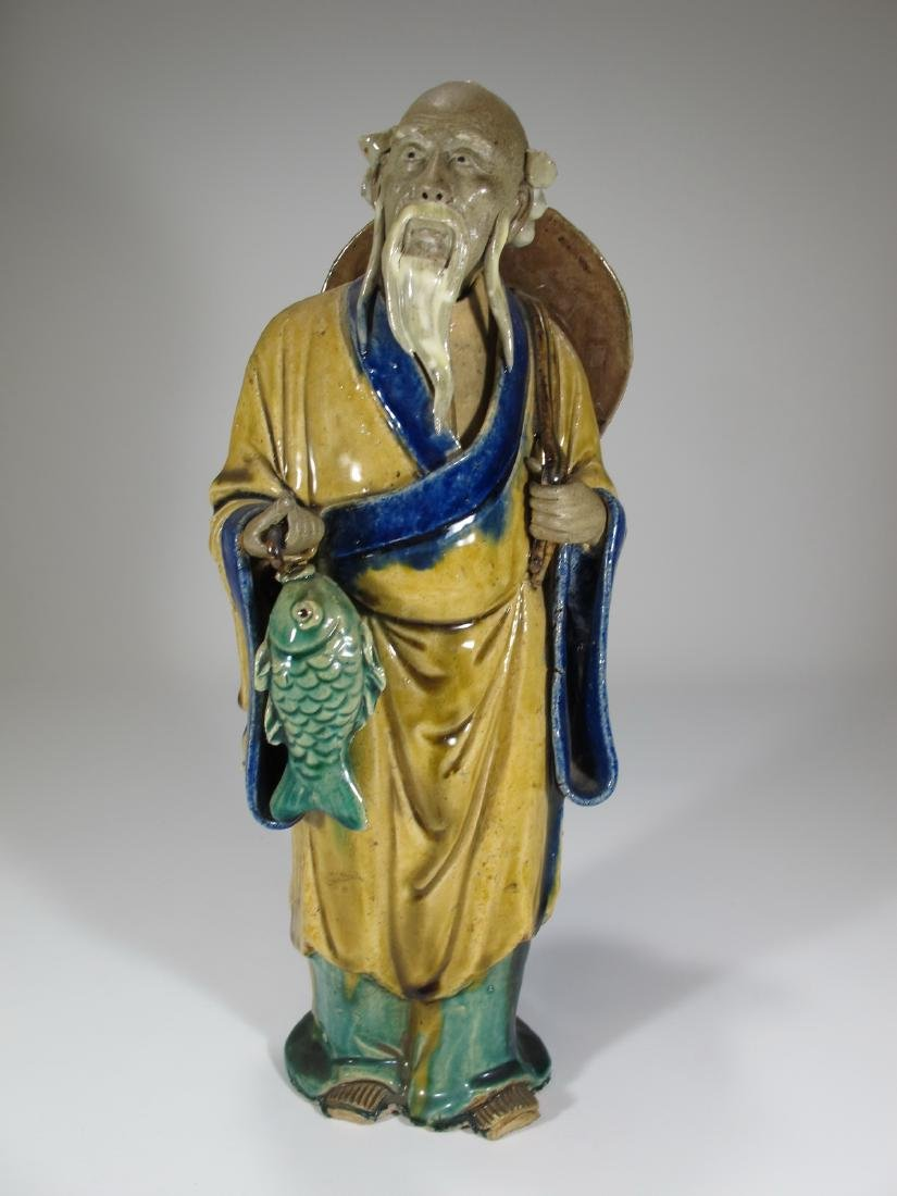 Vintage Chinese ceramic fisherman sculpture