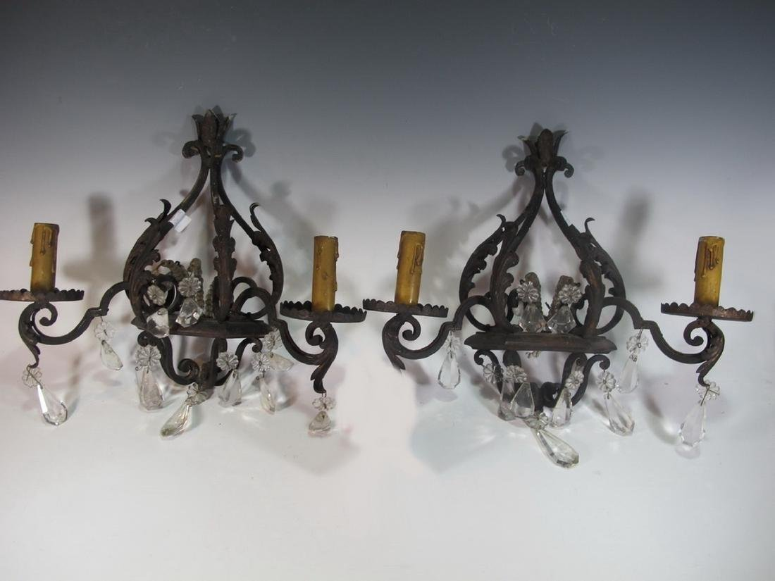 Antique pair of hollow wrought iron & crystals sconces