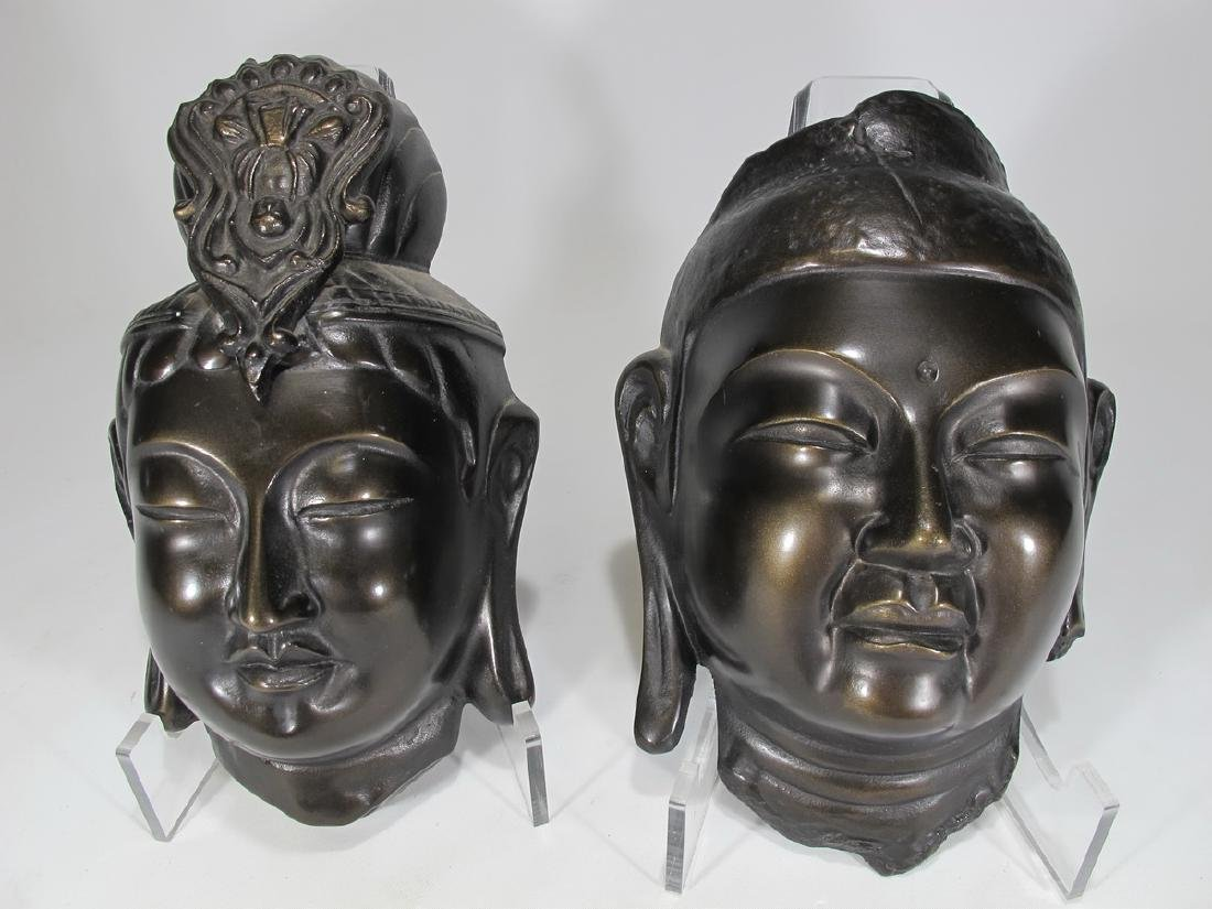 Chinese pair of patinated metal masks