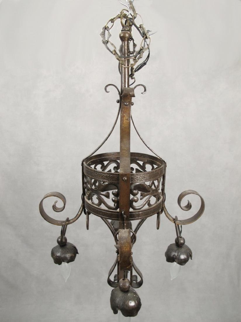 Antique French hammered iron chandelier