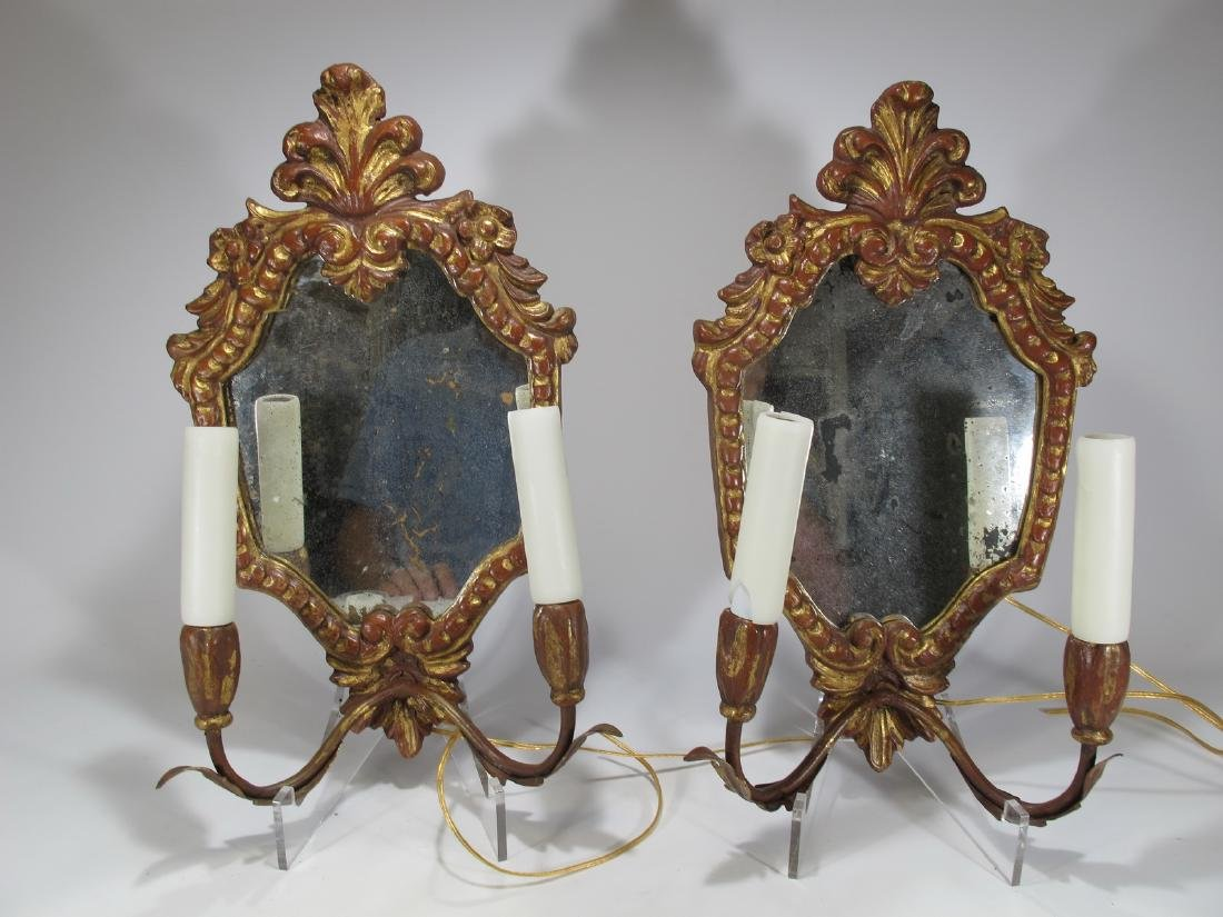 Vintage pair of mirrored gilded sconces