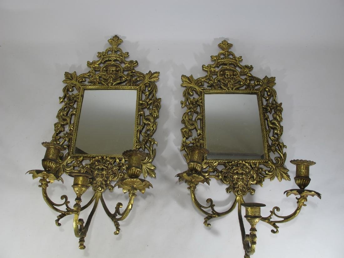 Vintage pair of bronze mirrored wall sconces