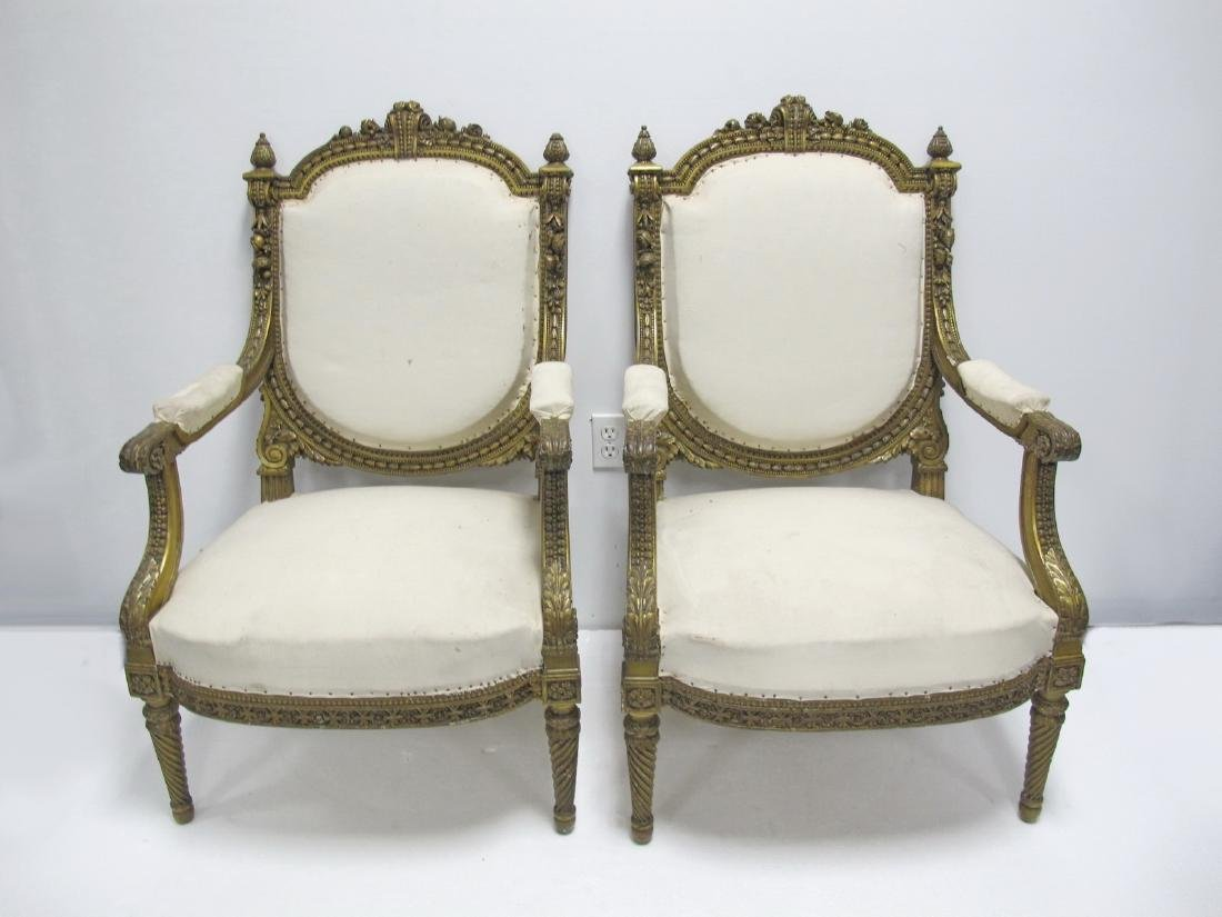 Antique pair of French Louis XVI style gilt armchairs