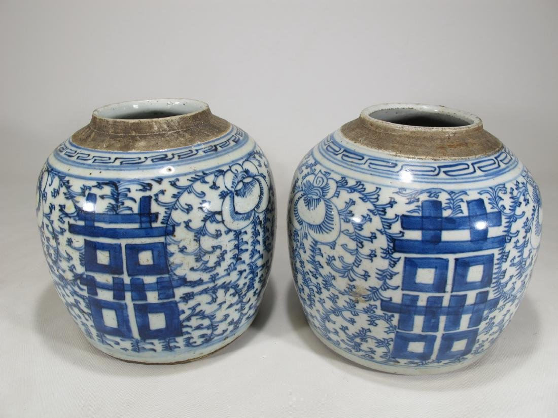 Antique Chinese pair of blue & white porcelain vases