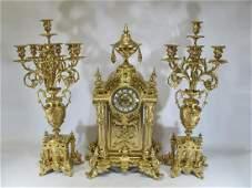 Antique French large gilt bronze clock set