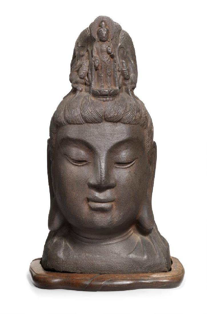 A Chinese Guanyin cast iron head. Ming 1368-1644. H. 59