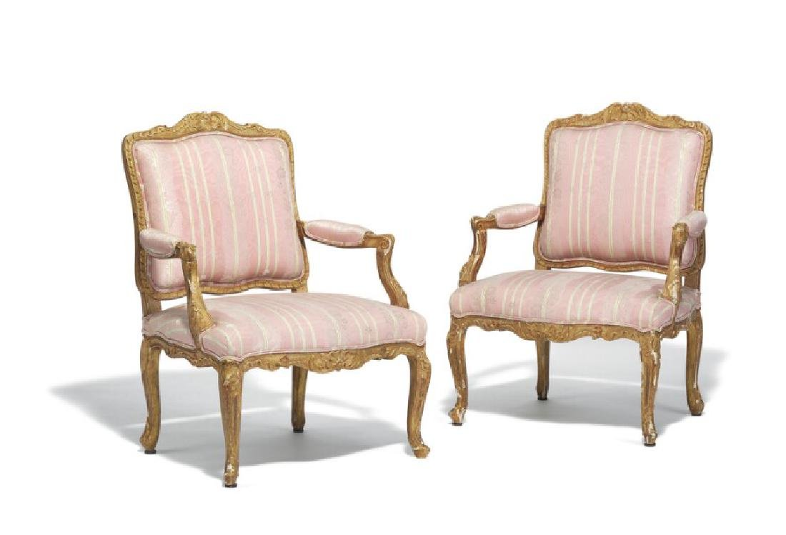 A pair of large French Louis XV giltwood armchairs,