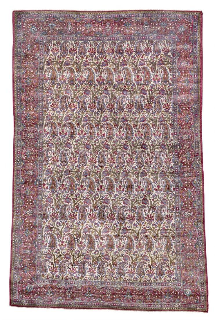 A Kashan full silk rug, Persia. All over boteh design