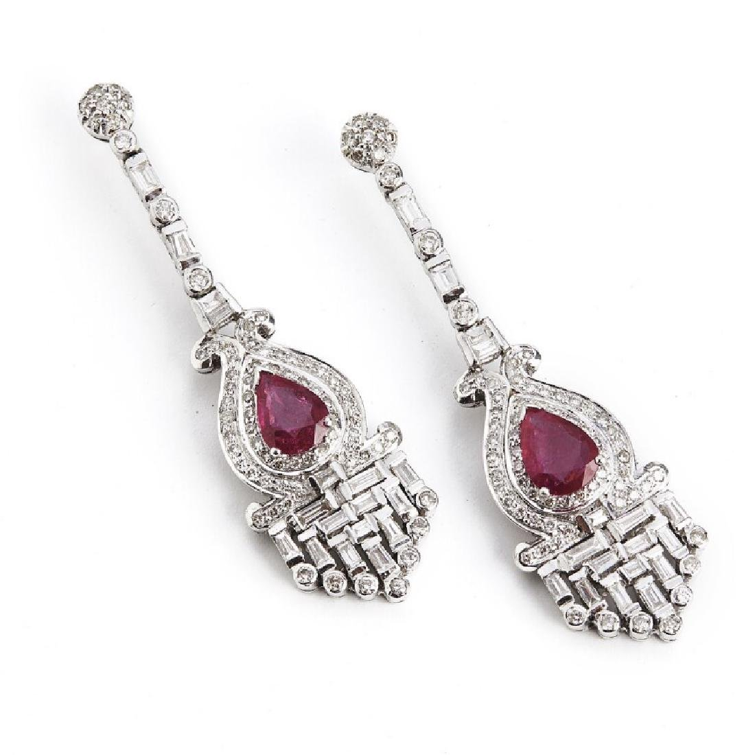 A pair of ruby and diamond ear pendants set with