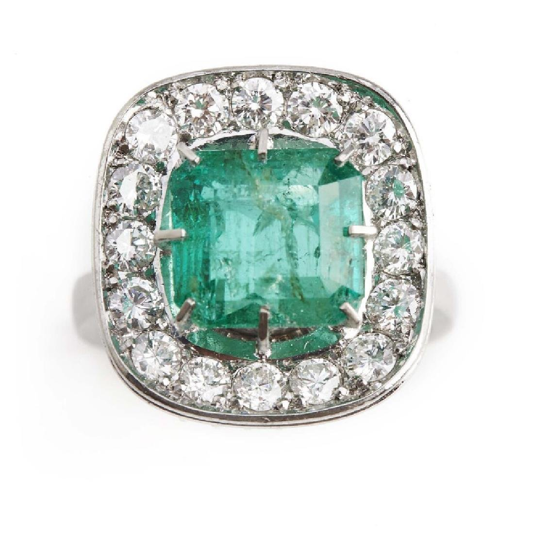 An emerald and diamond ring set with an emerald-cut