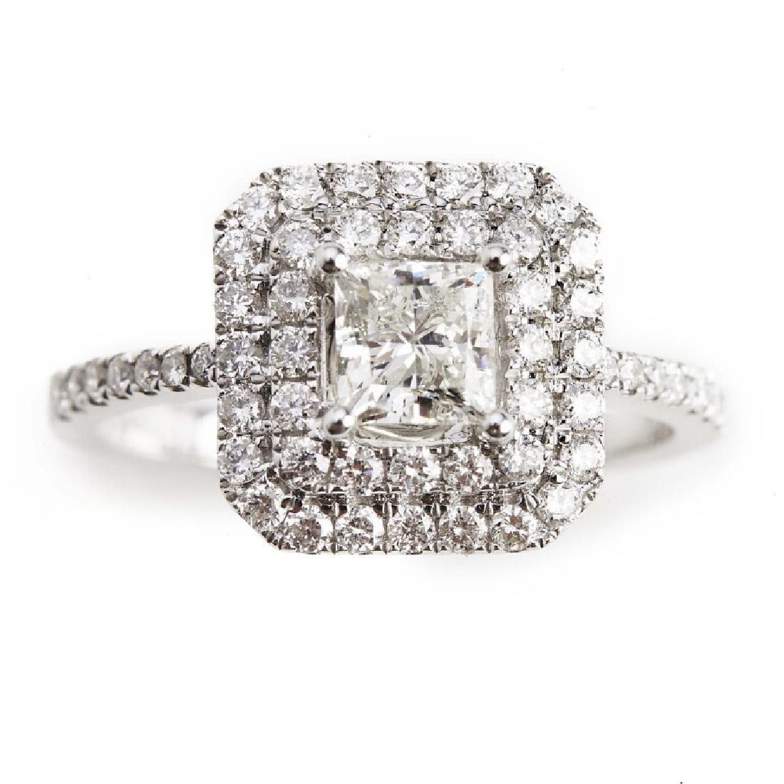 A diamond ring set with a princess-cut diamond and