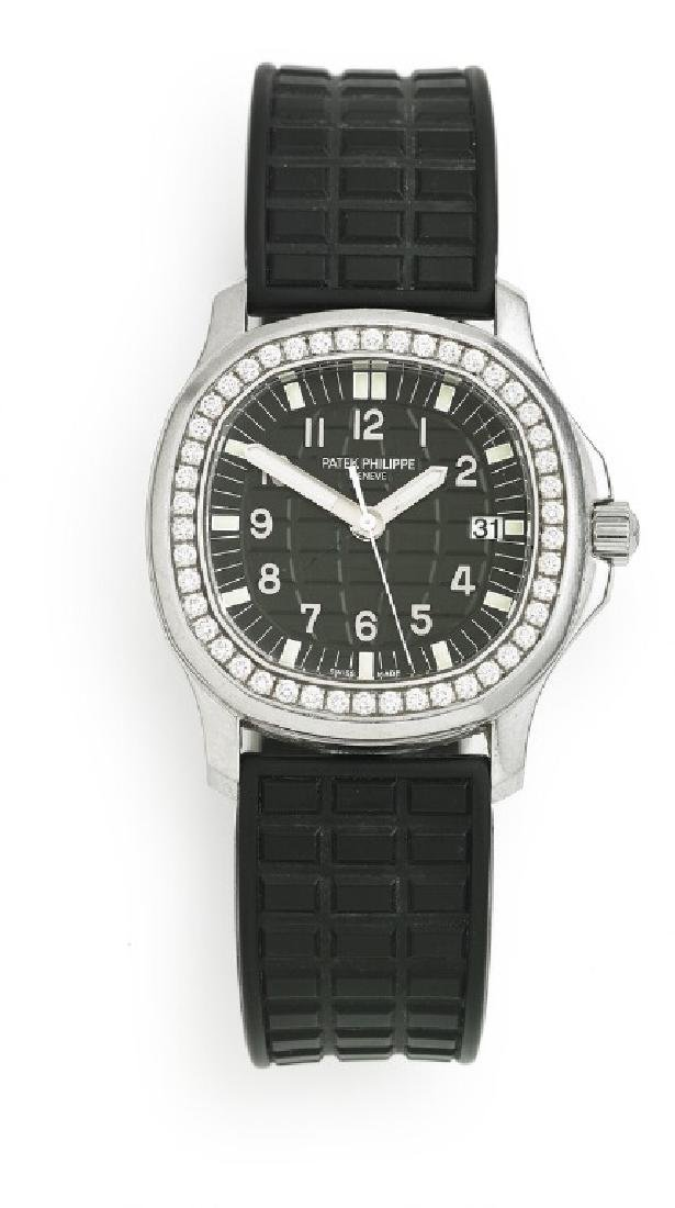 Patek Philippe: A lady's diamond wristwatch of steel.