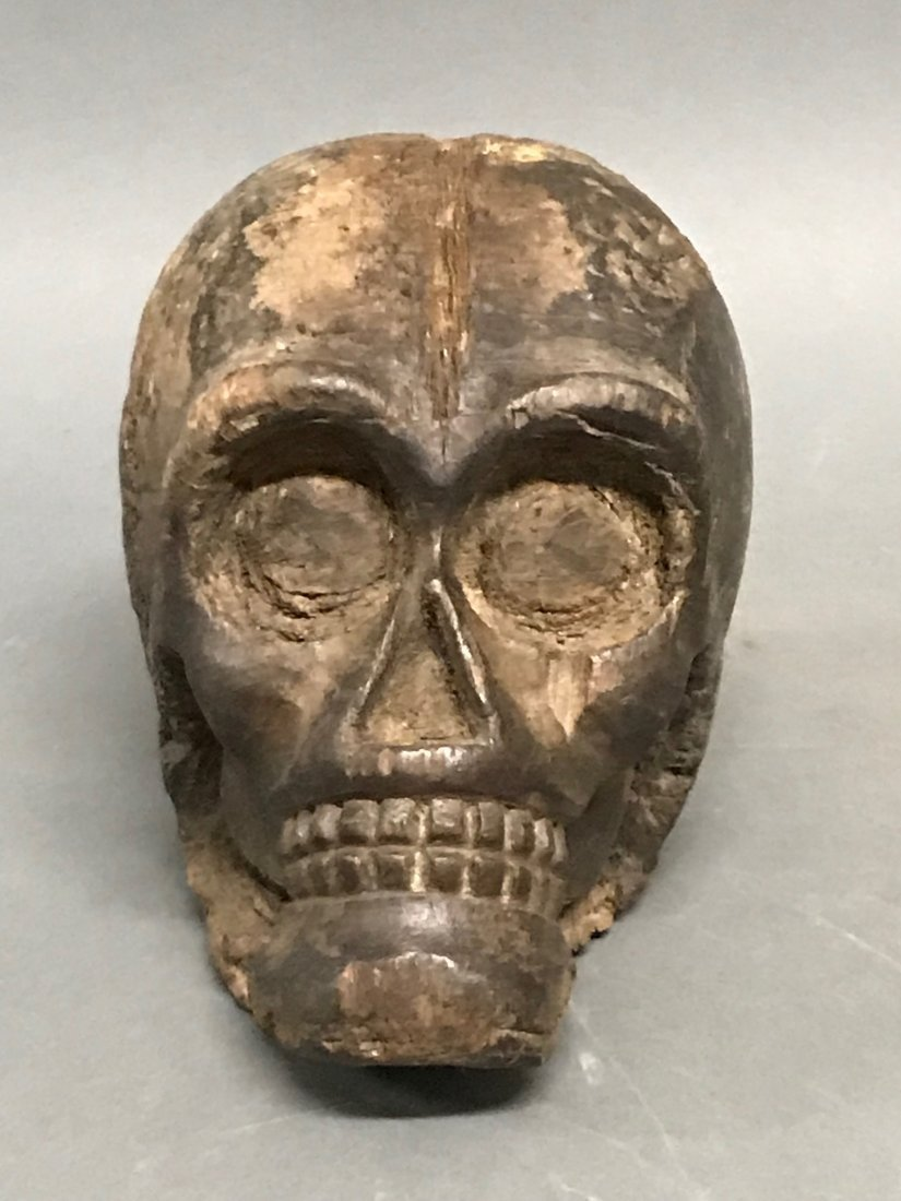 Wood carved skull