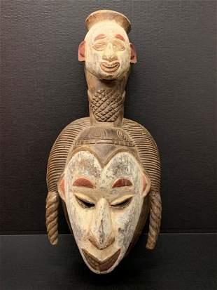 Ibo Mask with Ibo Head Statue